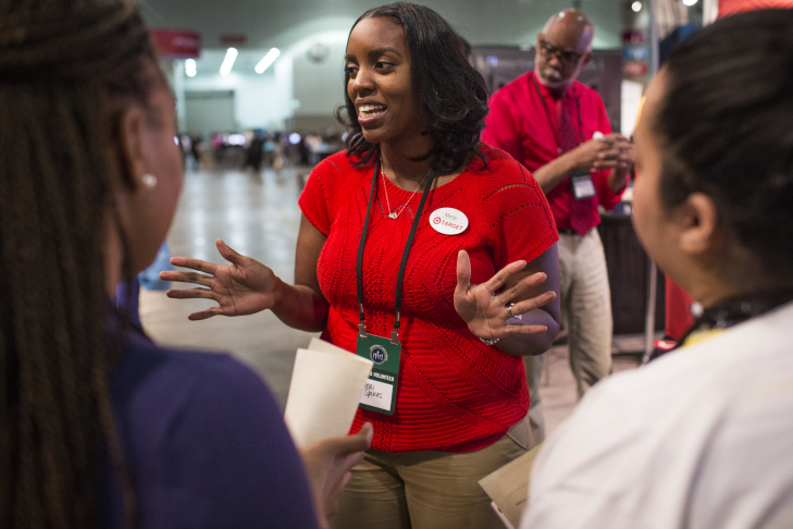 Ariel Flowers, 20, speaks with a Chipotle representative at the Los Angeles Convention Center on Thursday morning, Feb. 11, 2016 during the Los Angeles Opportunity Hiring Fair. Flowers, who was recently laid off, received two job offers on Thursday.