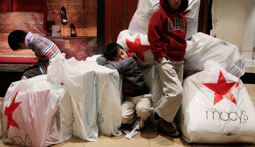 The Conference Board Tuesday said  Americans' confidence in the economy jumped in April 2013, helped by a better outlook for the job market and expectations for higher pay. Consumers' confidence in the economy is watched closely because their spending accounts for about 70 percent of U.S. economic activity. (Photo: Children wait with shopping bags inside Macy's department store on