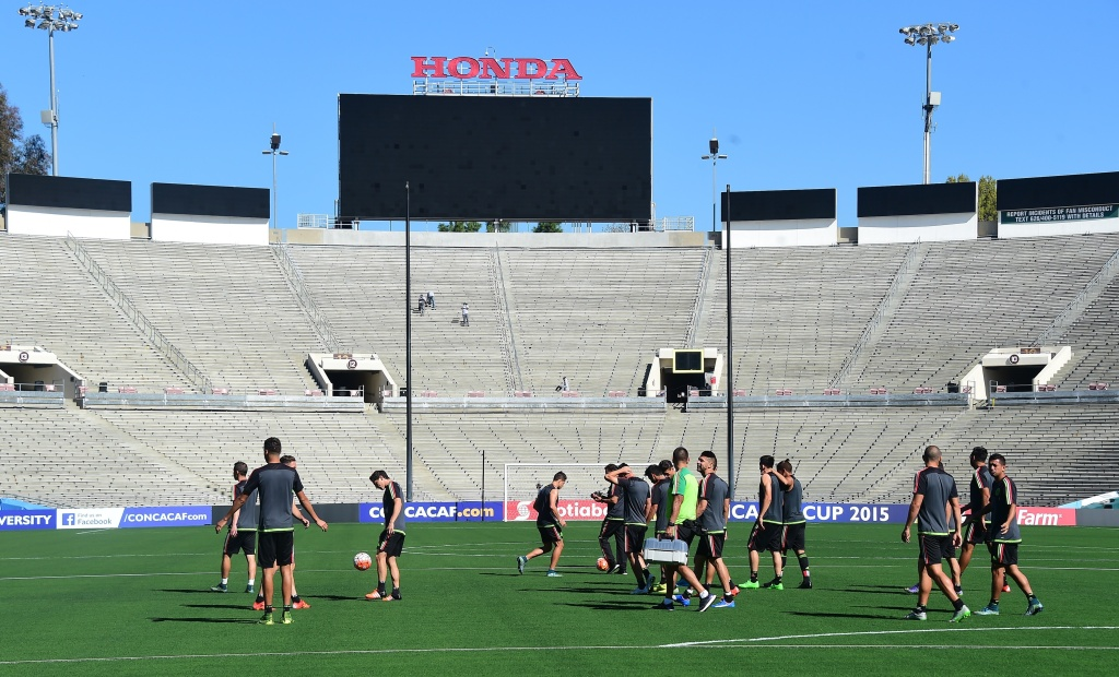 Mexico players arrive for a training session at the Rose Bowl in Pasadena, California on October 9, 2015, a day before Mexico plays the United States here in the playoff match for the Confederations Cup.  AFP PHOTO / FREDERIC J. BROWN        (Photo credit should read FREDERIC J. BROWN/AFP/Getty Images)