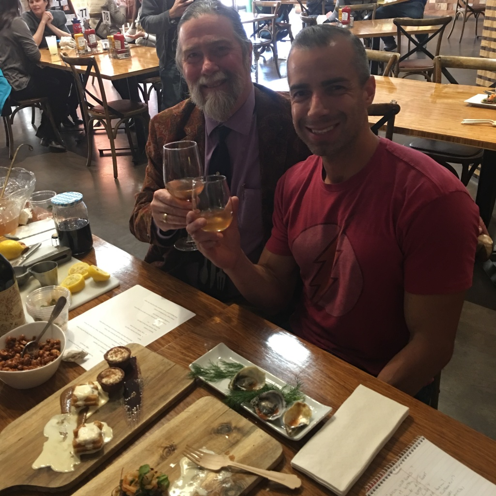 A Martinez toasts with Richard Foss, Culinary historian with the Autry Museum.