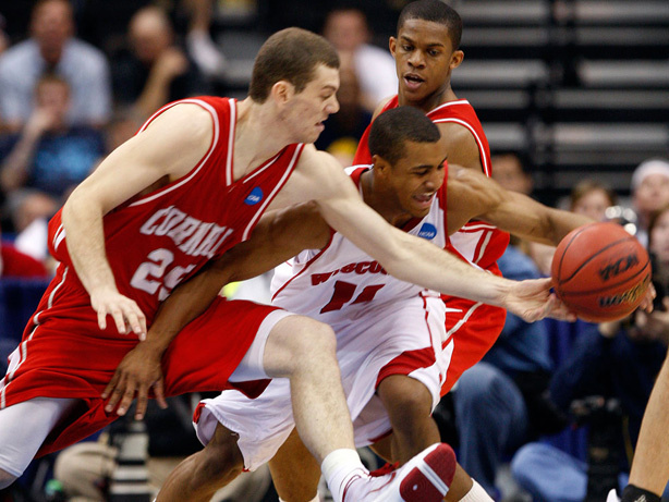 Cornell's Jon Jaques (25) and Wisconsin's Jordan Taylor go after a loose ball.