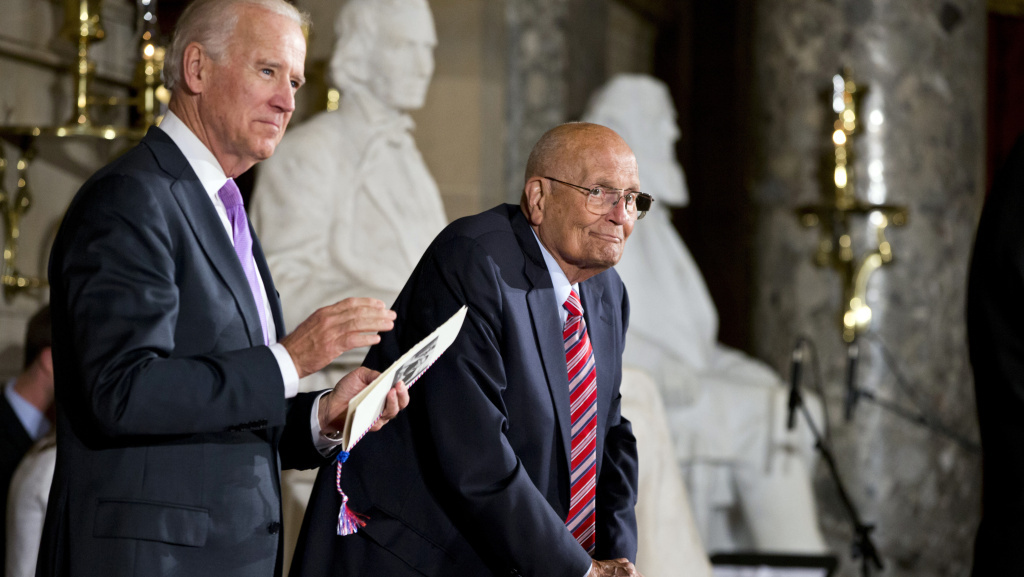 Rep. John Dingell, D-Mich., right, the longest-serving member of Congress, is celebrated by colleagues, including Vice President Joe Biden, left, on Capitol Hill in June 2013. A former chairman of the Energy and Commerce Committee, Dingell, now 87, announced in February that he will retire after this term.