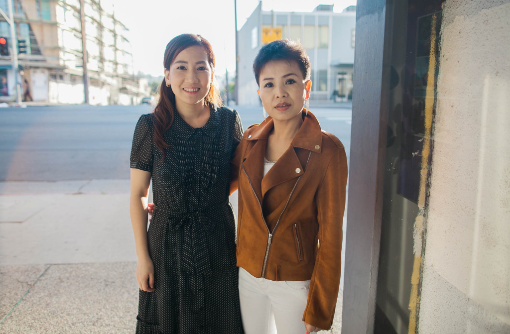 North Korea refugee May Joo, right, and American advocate Sarah Cho stop for a picture after a church service in Los Angeles, California, on Sunday Feb. 4, 2018.