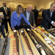 Former Rep. Gabby Giffords and her husband, Mark Kelly, at a gun show in Saratoga Springs, N.Y., in October. Giffords was shot in the head in a 2011 mass shooting in Tucson. She and Kelly have since founded a political action committee to push for tougher