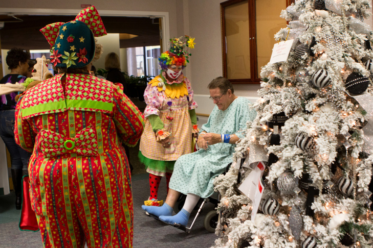 Jeanie McAulay, (Lady Bug), left, and Joyce Payne (Joy), wait outside an exam room before walking to the transitional care unit at Torrance Memorial Medical Center in Torrance, Calif., Monday, December 11, 2012. The two volunteer as clowns at the hospital in attempt to bring cheer to patients young and old.