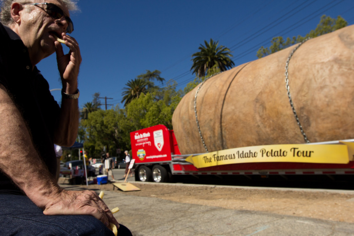 Elijh, 4, of Pasadena played with bean bags in front of The Great Big Idaho Potato Truck on its visit to the Fork in the Road in Pasadena, Calif., Tuesday, October 16, 2012. The 11.5-foot tall potato towered over Pasadena residents.