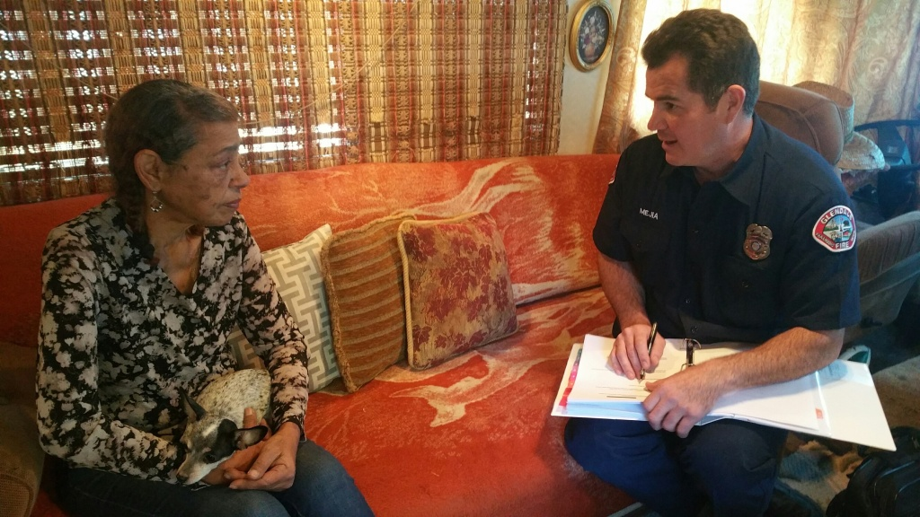 Glendale Fire Dept. Paramedic Gilberto Mejia meets with congestive heart failure patient Lucy Colon, 59, in a pilot program designed to keep patients like her from being readmitted to the hospital.