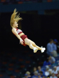 University of Arkansas cheerleaders perform high flying stunts during the SEC Men's Basketball Tournament game between the Louisiana State University Tigers and the University of Arkansas Razorbacks at the Louisiana Superdome on March 13, 2003.