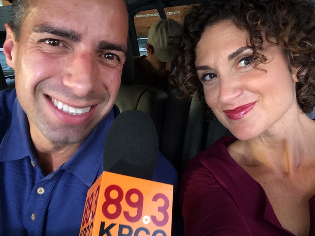 Take Two hosts A Martinez and Alex Cohen pose for a selfie.