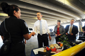 President Barack Obama (2nd L) and Homeland Security Secretary Janet Napolitano (3rd L) visit a border post between the US and Mexico on May 10, 2011 in El Paso, Texas.