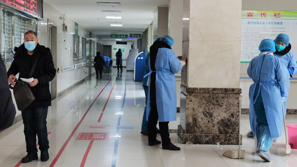 Medical staffs sterilize the main building of Jinyintan Hospital on Jan. 22 in Wuhan, China. An 60-year-old from who died at the hospital on Thursday is the first American known to have died after being infected by the coronavirus.