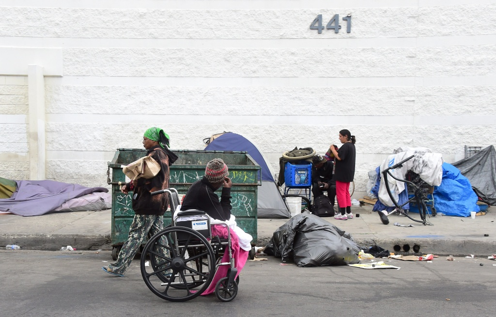 Homeless women prepare for another day and night on the street near Skid Row.