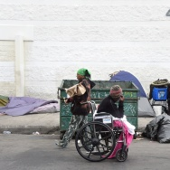 Homeless women prepare for another day and night on the street near Skid Row in Los Angeles, California on May 12, 2015.