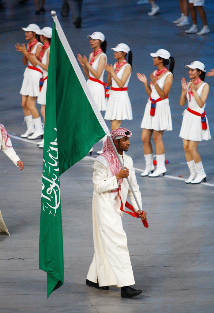 Runner Mohammed Salman H. Al-Khuwaildi of Saudi Arabia carries his country's flag during the Opening Ceremony for the 2008 Beijing Summer Olympics at the National Stadium on August 8, 2008 in Beijing, China.