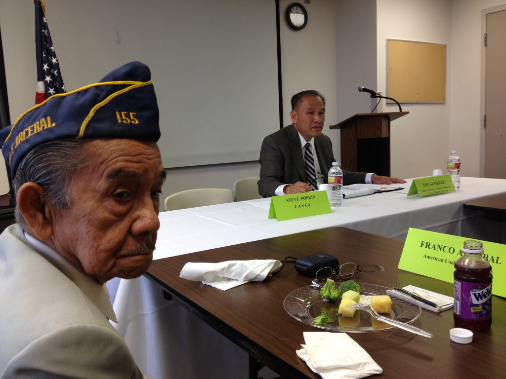 Franco Arcebal, a former Filipino guerrilla intelligence officer in WWII, at a meeting in Los Angeles with a Department of Veterans' Affairs representative. In Southern California, Filipino Americans are among the Asian American groups with the most economic success, according to a new report; other groups haven't fared as well.