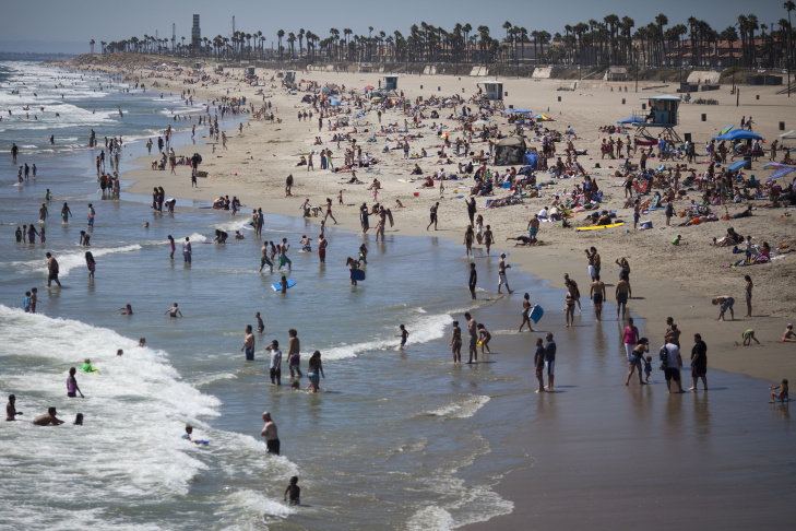 Huntington Beach is busy with beachgoers on a recent afternoon. The beach will host the U.S. Open of Surfing starting Saturday.