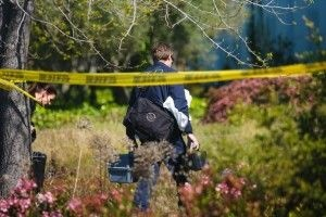 A crime scene investigator last week at Oikos University in Oakland.