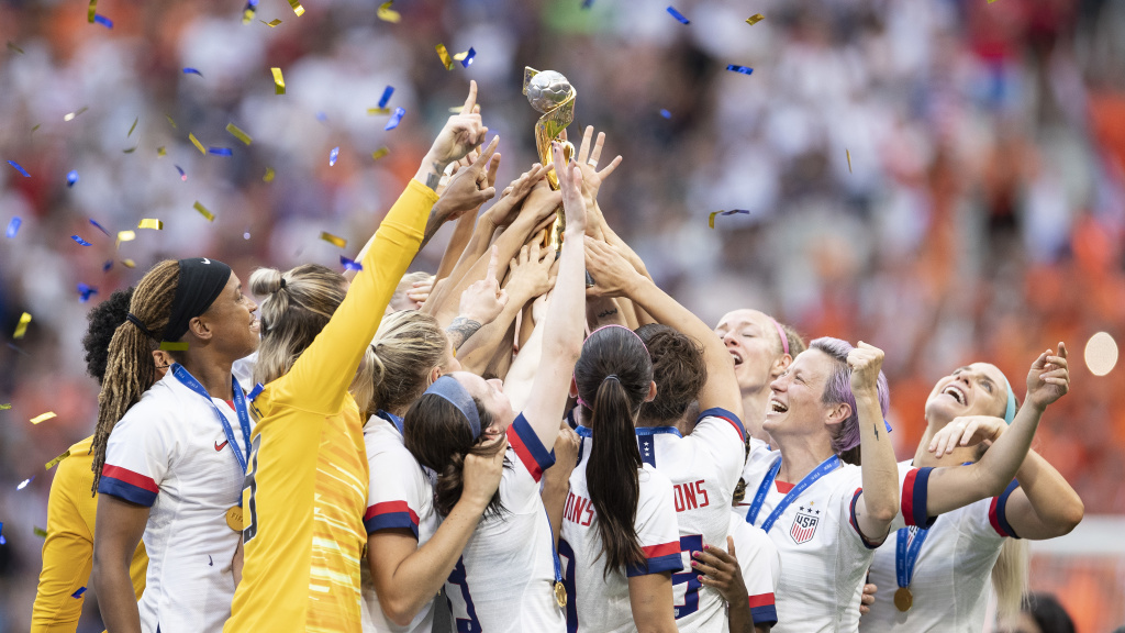 U.S. Women's National Team players celebrate with the FIFA Women's World Cup Trophy following team's victory Sunday.