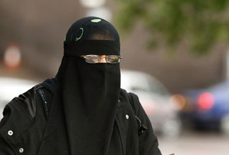 A woman wears a full face Niqab on the streets July 20, 2010 in Blackburn, England. Syria has banned the wearing of full face veils in its universities.