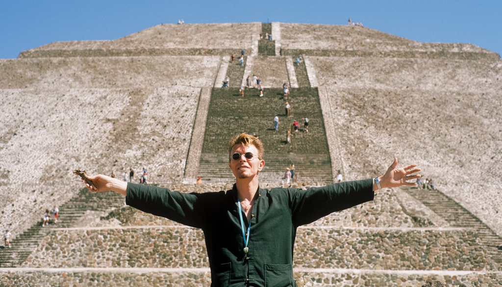 David Bowie stretches his arms in front of the Pyramid of the Sun at Teotihuacan during his trip to Mexico City in 1997.