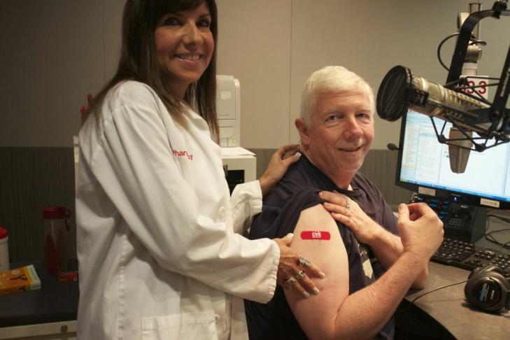 CVS Pharmacist Jill Kolin administers a flu shot to KPCC's morning anchor Steve Julian. Why so serious?