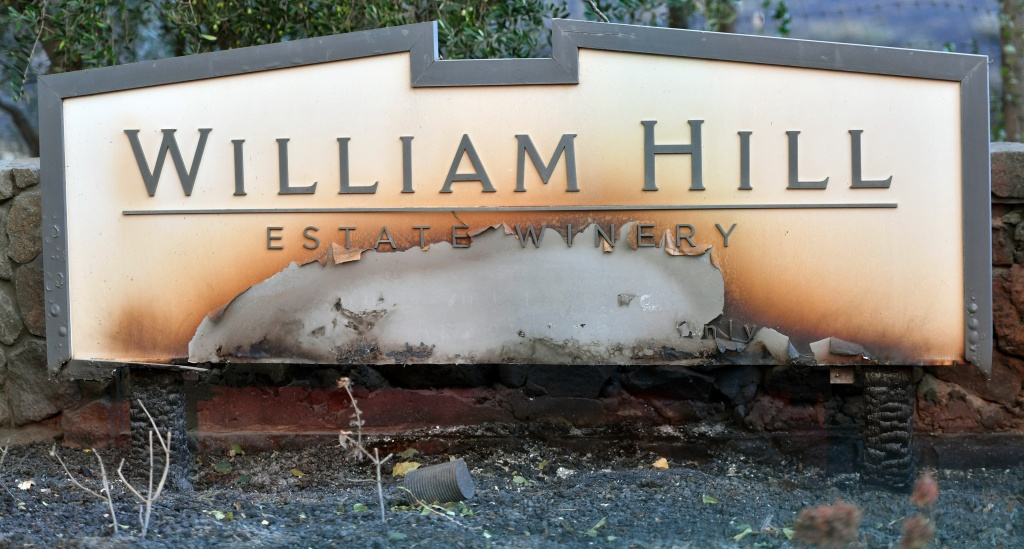 The partially burnt sign for the William Hill Estate Winery sign is seen in Napa, California on October 9, 2017.