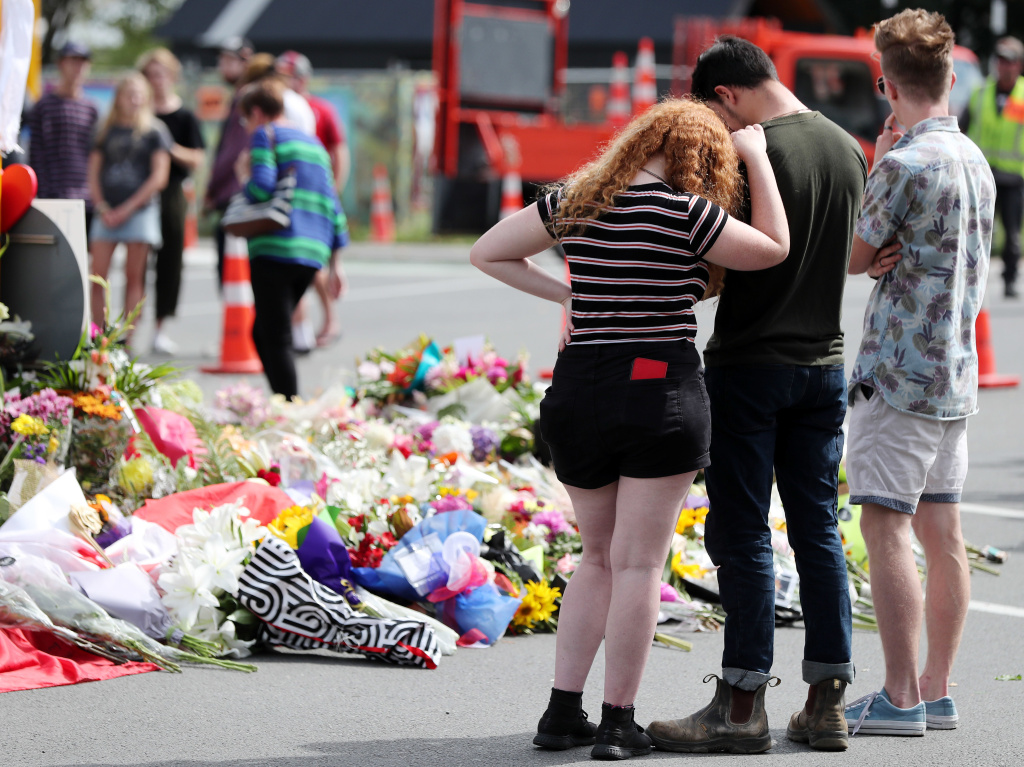 Residents pay their respects by placing flowers for the victims of the mosques attacks in Christchurch.