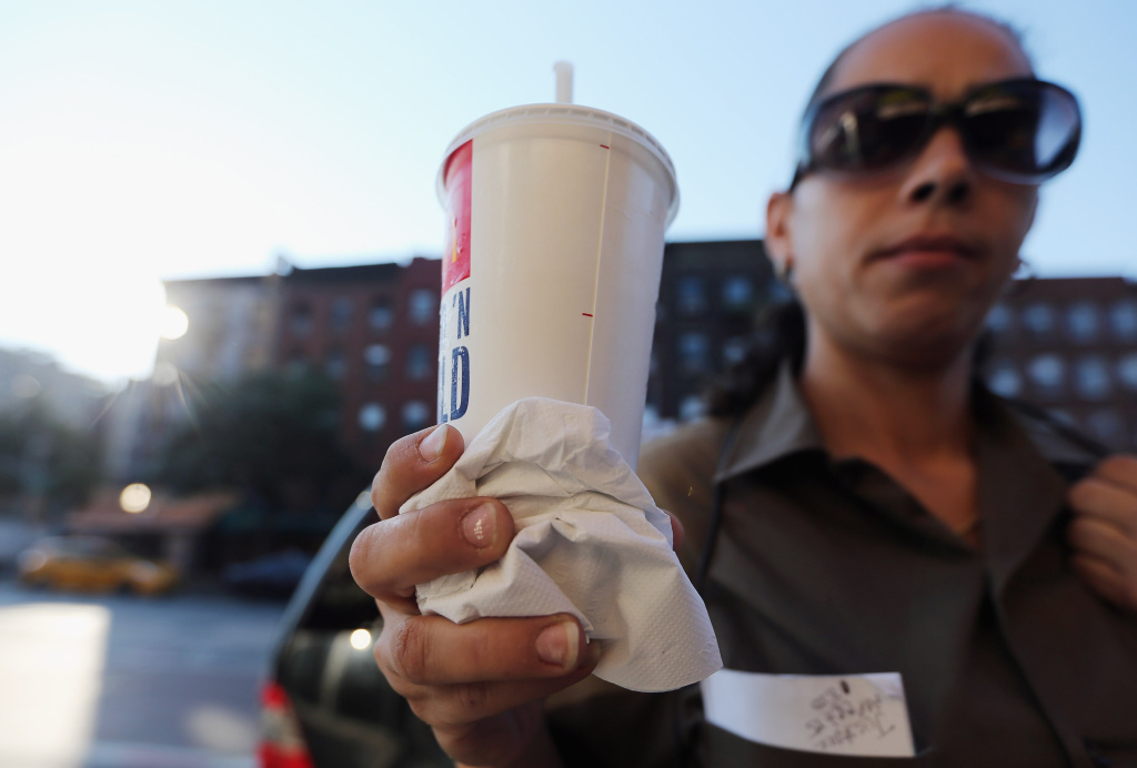 Jasmine Batista displays a 21-ounce soda she purchased at McDonalds in Manhattan after the New York City Board of Health voted to ban the sale of large sugary drinks at restaurants and concessions on September 13, 2012 in New York City.