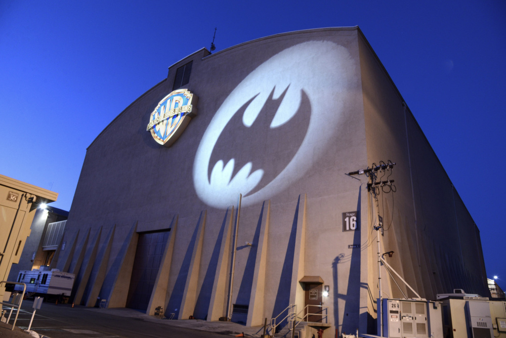 The Bat-Signal lights the side of Stage 16 at Warner Bros. Studio on Aug. 18, 2014, in Burbank. The signal will be projected on Los Angeles City Hall on June 15 in honor of the late actor Adam West, who starred in the campy TV series.