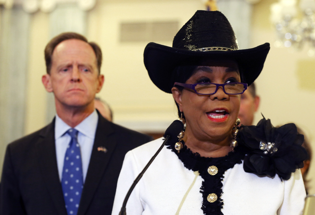 Rep. Frederica Wilson speaks about protecting students from sexual predators while Sen. Pat Toomey listens during a news conference on Capitol Hill on September 9, 2014.