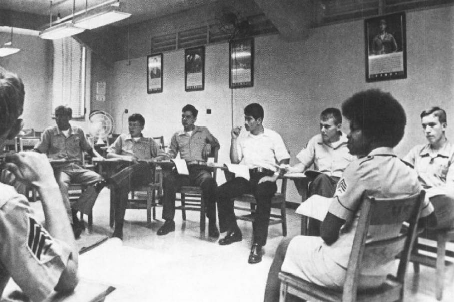 Sergeant Brenda Good (foreground), a human relations instructor, guides a discussion group of Marines in the early 1970s. The Marine Corps said the mandatory seminars were intended to 'develop understanding and tolerance of each others' background and point of view.'