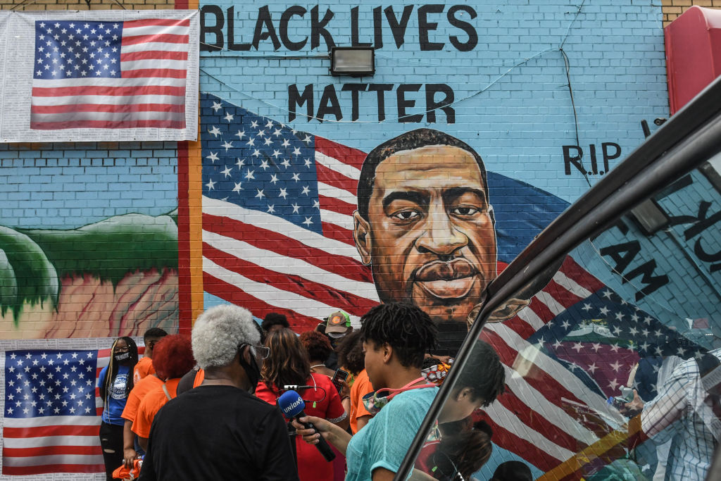 A mural painted by artist Kenny Altidor depicting George Floyd is unveiled on a sidewall of CTown Supermarket on July 13, 2020 in the Brooklyn borough New York City.
