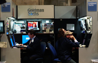 Financial professionals work in the Goldman Sachs booth on the floor of the New York Stock Exchange April 16, 2010 in New York, New York. Goldman Sachs was charged with fraud by the Securities and Exchange Commission over its marketing of a subprime mortgage product, sending its stock price sharply lower.