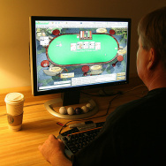 A man plays poker on his computer connec