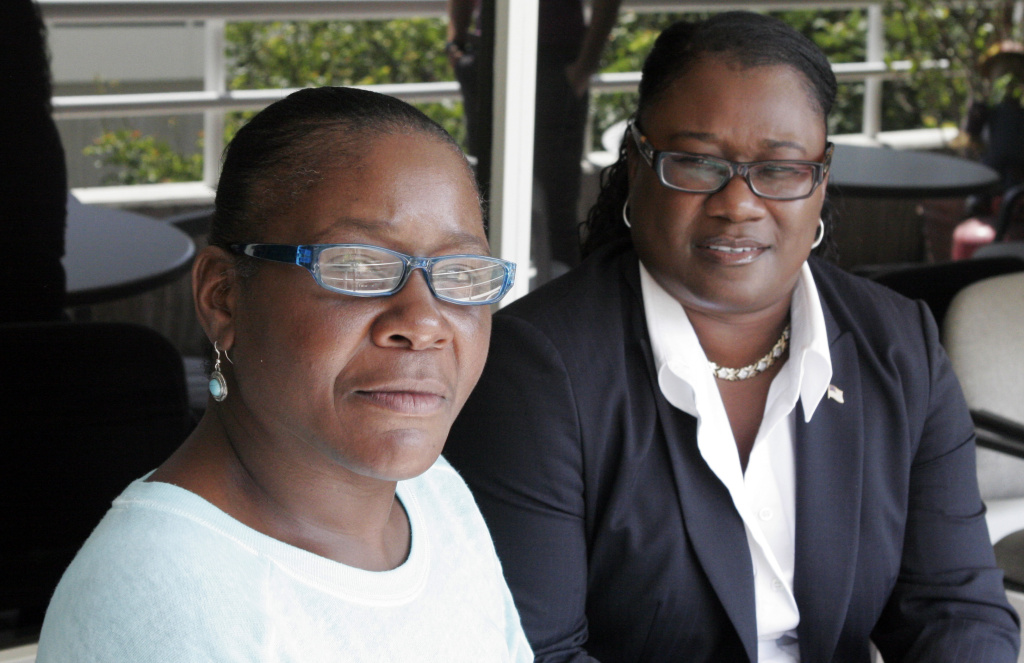 File: Marlene Pinnock, left, poses with her attorney, Caree Harper during an interview Sunday Aug. 10, 2014 in Los Angeles. Pinnock, a homeless woman was beaten by a CHP officer in July 2014. The Los Angeles Times says Harper was sanctioned Monday in Los Angeles for refusing to say how she met Marlene Pinnock and when she learned the woman might be mentally incompetent.