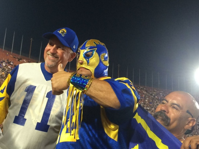 August 20, 2016: An L.A. Rams fan combines his love for the team and his appreciation for Mexican wrestling at a game between the Rams and the Kansas City Chiefs at the L.A. Coliseum.