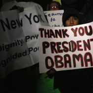 A demonstrator in New York holds a sign in support of President Obama's executive action announcement, Nov. 21, 2014. The GOP-led House has passed a bill that seeks to undo the order; Senate Democrats are reportedly trying to prevent it from getting a Senate floor vote.
