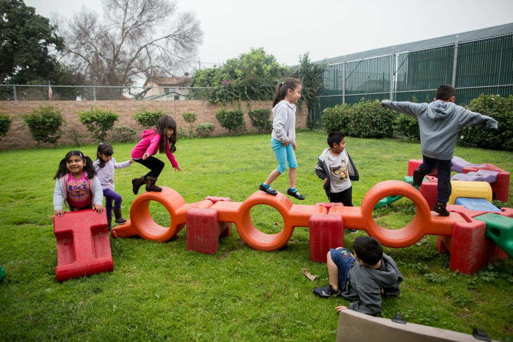 Children in the transitional kindergarten (TK) program play during recess at the Martha Escutia Primary Center. TK was created by a new law called the Kindergarten Readiness Act in 2010.