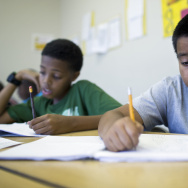 Eleven-year-old David Leon, right, attends the fourth week of a pre-algebra class at the West Angeles Church Youth Center on Thursday afternoon, July 30, 2015. The Summer Algebra Institute program aims to bring more students of color up to speed on math as part of ongoing efforts to improve their college entry rates.
