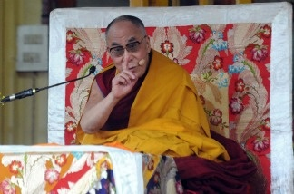 Tibetan Spiritual Leader the Dalai Lama gestures as he addresses devotees during a teaching session at a Buddhist Temple in Dharamashala on March 19, 2011.