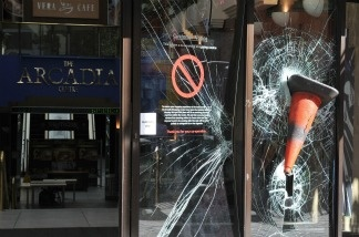 A traffic cone is embedded in the smashed windows of the Arcadia shopping centre on Ealing Broadway following a night of rioting in Ealing on August 9, 2011 in London, England.