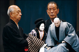 It takes three men to operate a Bunraku puppet.