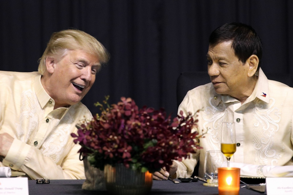 US President Donald Trump (L) speaks with Philippines President Rodrigo Duterte during a special gala celebration dinner for the Association of Southeast Asian Nations (ASEAN) in Manila on November 12, 2017. World leaders arrive in the Philippines' capital for two days of summits beginning on November 13.  / AFP PHOTO / POOL / ATHIT PERAWONGMETHA        (Photo credit should read ATHIT PERAWONGMETHA/AFP/Getty Images)