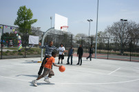 Kids play basketball on a court at the Martin Luther King park at Western Avenue and 39th Street in south Los Angeles.