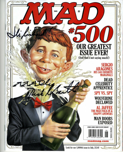 Mad Magazine mascot Alfred E. Neuman shows off the debut cover of the publication's new look at a New York news conference Tuesday, April 1, 1997.
