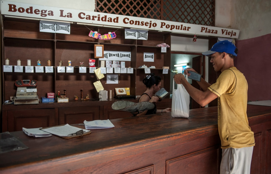 A customer gets his monthly rice quota in a store in Havana, Cuba. The Cuban government announced it will begin publishing classified ads in print and online for items ranging from houses to pirated American TV shows.