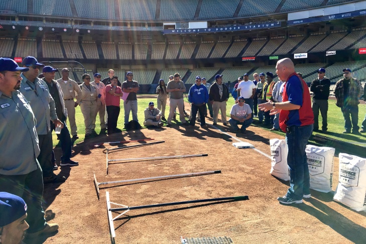 Mike Boekholder, Head Groundskeeper for the Philadelphia Phillies, teaches a clinic on maintaining infield dirt.
