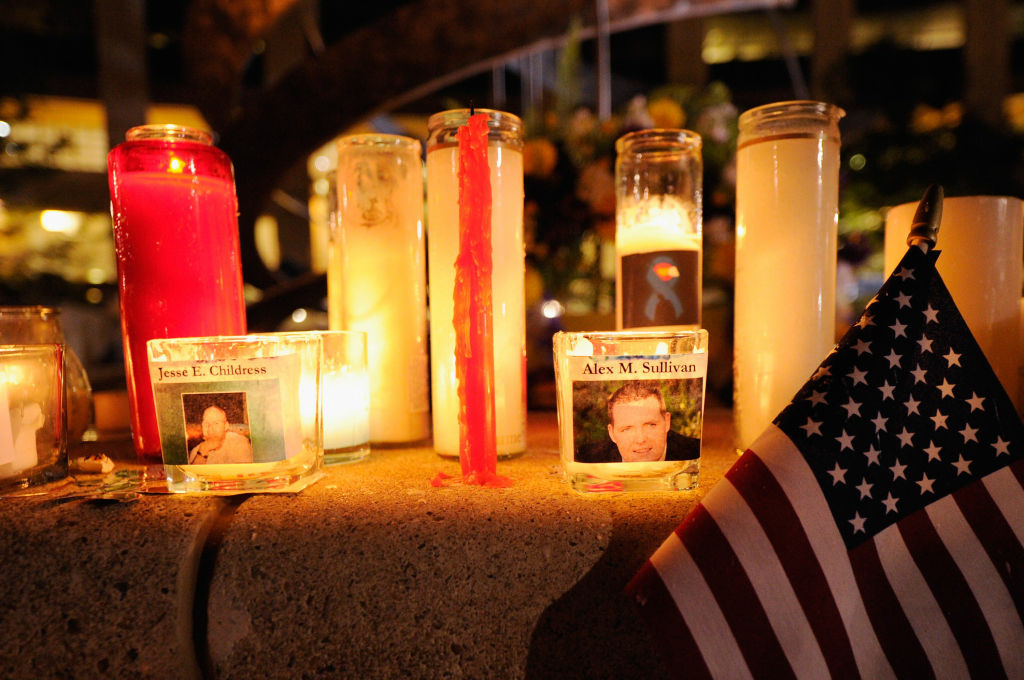 Mourners create a memorial at the fountain of Aurora Municipal Center after a prayer vigil for the 12 victims of Friday's mass shooting at the Century 16 movie theater, on July 22, 2012 in Aurora, Colorado. Suspect James Holmes, allegedly went on a shooting spree and killed 12 people and injured 59 during an early morning screening of 'The Dark Knight Rises.'