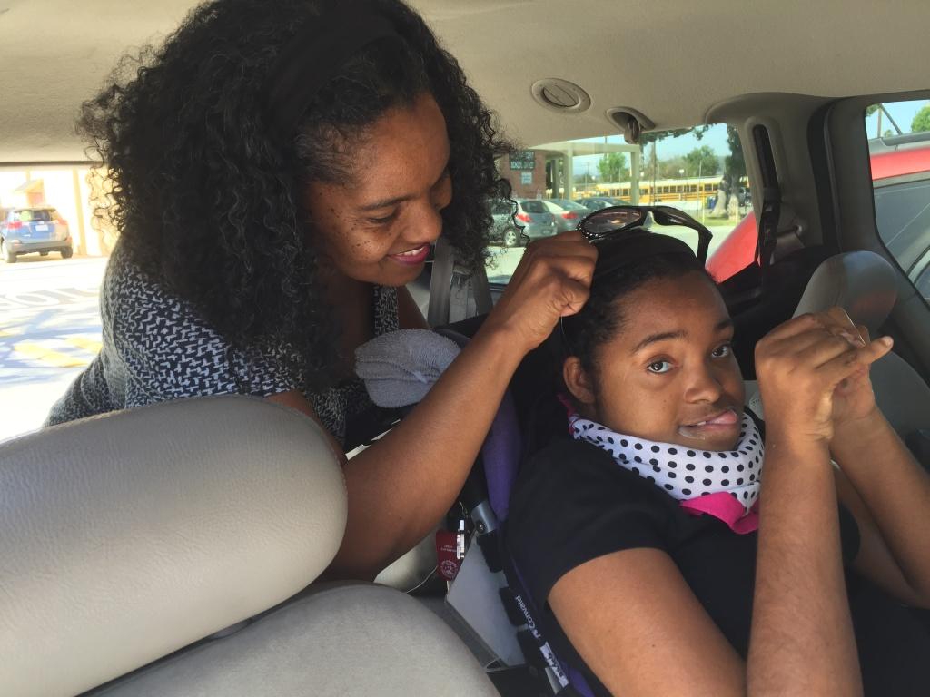Sherri Brady locks Lauren Messer's wheelchair into her van.