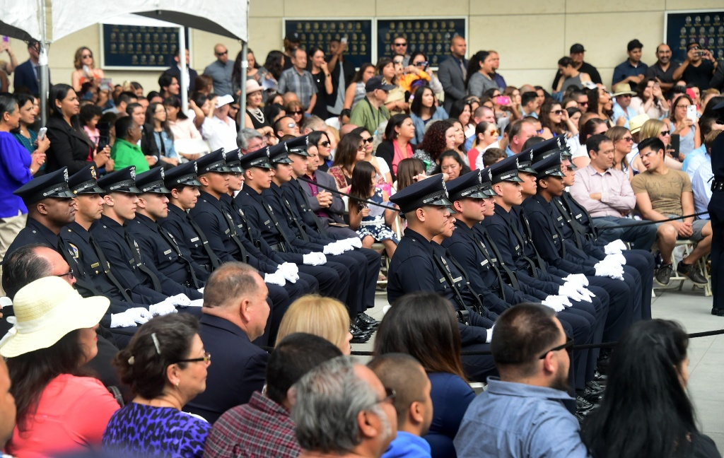 Police recruits attend their graduation ceremony at LAPD Headquarters on July 8, 2016 in Los Angeles, California.